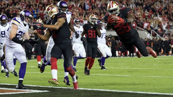 Sep 14, 2015; Santa Clara, CA, USA; San Francisco 49ers running back Carlos Hyde (28) dives for a touchdown with a block from quarterback Colin Kaepernick (7) against the Minnesota Vikings during the second quarter at Levi's Stadium. Mandatory Credit: Kelley L Cox-USA TODAY Sports