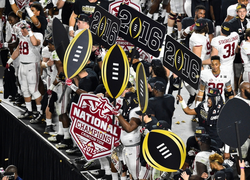 Jan 11, 2016; Glendale, AZ, USA; Alabama Crimson Tide players hold up championship signs after the game against the Clemson Tigers in the 2016 CFP National Championship at University of Phoenix Stadium. Alabama won 45-40. Mandatory Credit: Gary A. Vasquez-USA TODAY Sports